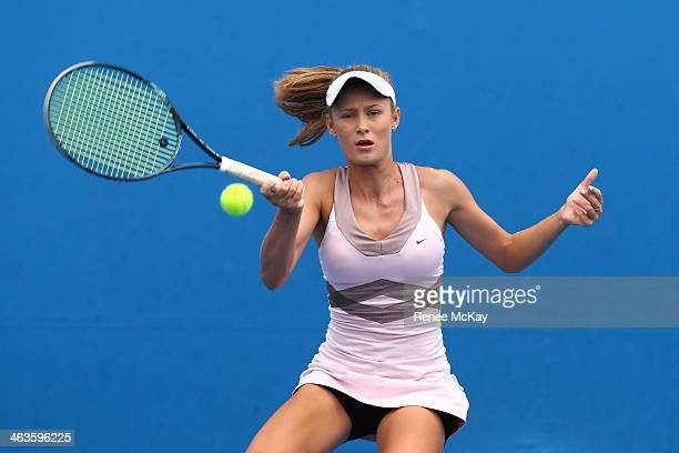 Kaylah McPhee of Australia plays a forehand in her first round junior girls' match against Jelena Ostapenko of Latvia during the 2014 Australian Open...