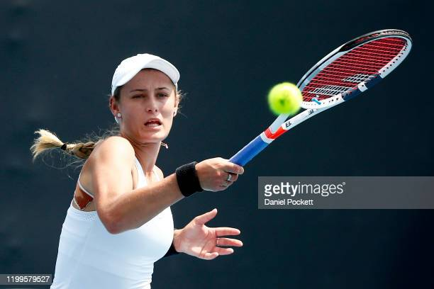 Kaylah McPhee of Australia plays a forehand in her match against Greet Minnen of Belgium during day two of 2020 Australian Open Qualifying at...