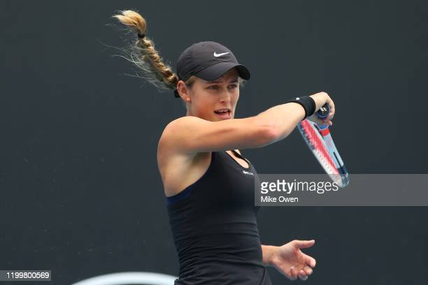 Kaylah McPhee of Australia plays a forehand in her match against Greet Minnen of Belgium during 2020 Australian Open Qualifying at Melbourne Park on...