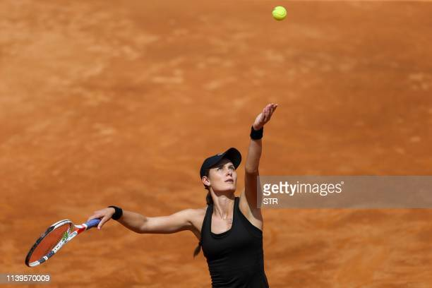 Kaylah McPhee of Australia serves against Zheng Saisai of China during their women's singles semifinal match at the Kunming Open tennis tournament in...