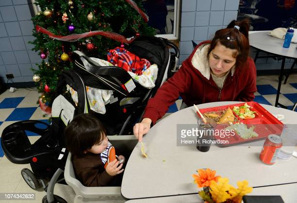 Kayle Quillen right feeds her son Omar during dinner at the Samaritan House on December 17 2018 in Denver Colorado Through a series of medical...