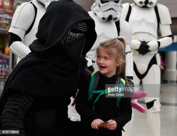 Kaylee Ethier isn't sure what to think about a Star Wars character Kylo Ren grandson of Darth Vader at the May the Fourth Be With You Star Wars day...