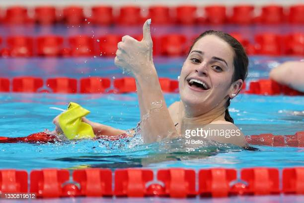 Kaylee McKeown of Team Australia celebrates after winning the gold medal in the Women's 100m Backstroke Final on day four of the Tokyo 2020 Olympic...