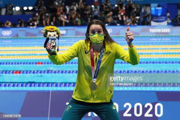 Kaylee McKeown of Team Australia poses with the gold medal after winning the Women's 100m Backstroke Final on day four of the Tokyo 2020 Olympic...