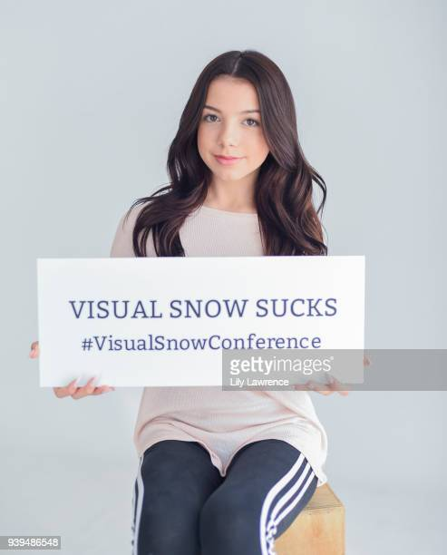 Kaylee Quinn poses with Visual Snow Conference at The Artists Project Giveback Day on March 28 2018 in Los Angeles California
