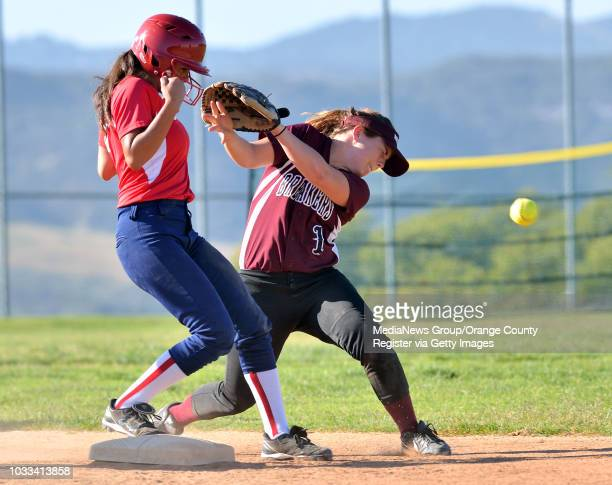 Kayleen Rodrigquez left of Bolsa Grande gets back to second base safely after the throw for an attempted pickoff gets past Jessica Roediger right of...