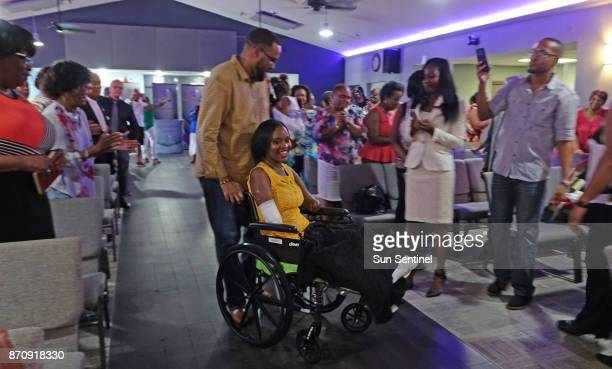 Kayleigh FergusonWalker who lost her limbs because of a sepsis infection is pushed in her wheelchair by her husband Ramon on Saturday Sept 2 into a...
