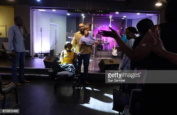Kayleigh FergusonWalker who lost her limbs because of a sepsis infection is pushed in her wheelchair by her daughter Aaliyah and husband Ramon on...