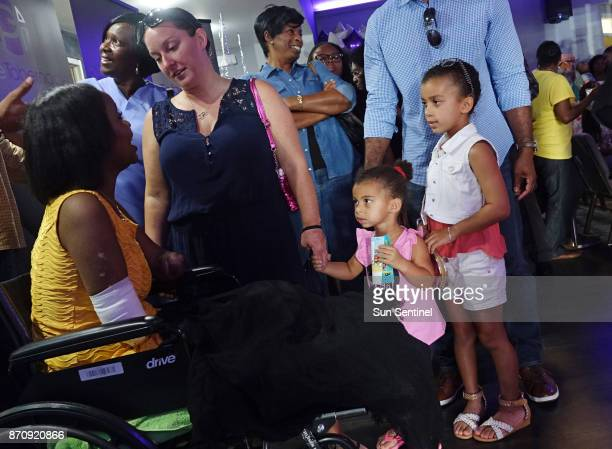 Kayleigh FergusonWalker who lost her limbs because of a sepsis infection is greeted by Rachel Cunningham and her children Jacksyn and Kendall on...