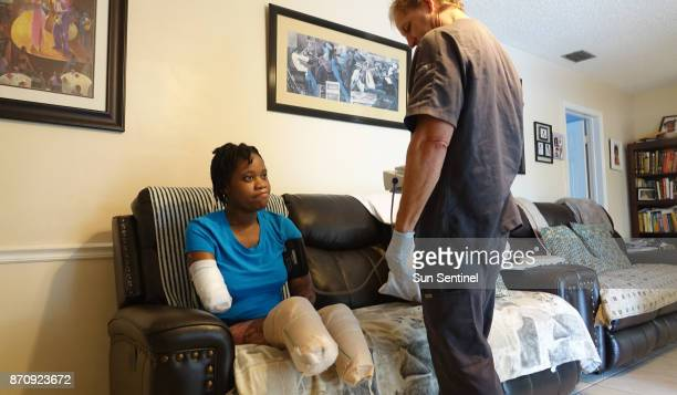 Kayleigh FergusonWalker who lost her limbs because of a sepsis infection works with phsical therapist John Quakenbush on Tuesday Aug 22 2017 at her...