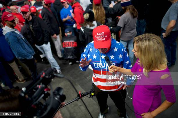 Kayleigh McEnany National Press Secretary for US President Donald J Trump interviews a supporter wearing a KEEP AMERICA GREAT hat before a campaign...
