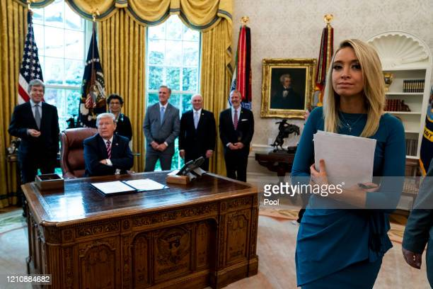 Kayleigh McEnany , the White House press secretary, attends a signing ceremony for H.R. 266, the Paycheck Protection Program and Health Care...