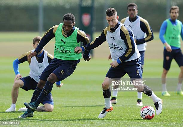 Kaylen Hinds and Laurent Koscielny of Arsenal during a training session at London Colney on April 8 2016 in St Albans England