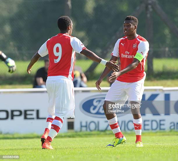 Kaylen Hinds celebrates scoring Arsenal's 1st goal with Alex Iwobi during the UEFA Youth League Match between Borussia Dortmund and Arsenal at...