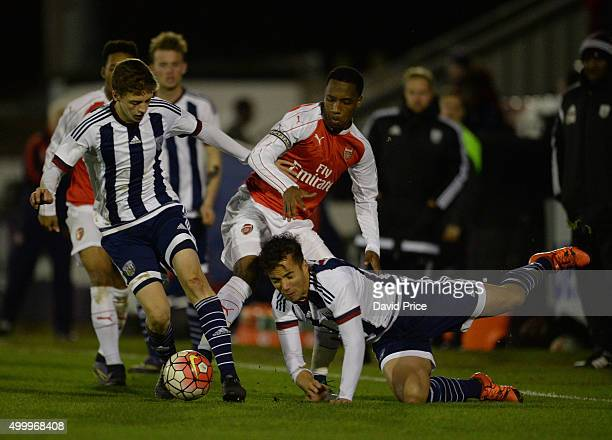 Kaylen Hinds of Arsenal battles for the ball with Sam Field and Kane Wilson of West Bromwich during the match between Arsenal U18 and West Bromwich...