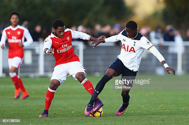 Kaylen Hinds of Arsenal challenges Shilow Tracey of Tottenham Hotspur during the Premier League 2 match between Tottenham Hotspur and Arsenal at...
