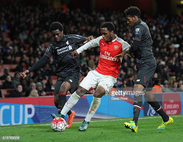 Kaylen Hinds of Arsenal holds off Ovie Ejaria and Kane Lewis of Liverpool during the match between Arsenal U18 and Liverpool U18 in the FA Youth Cup...