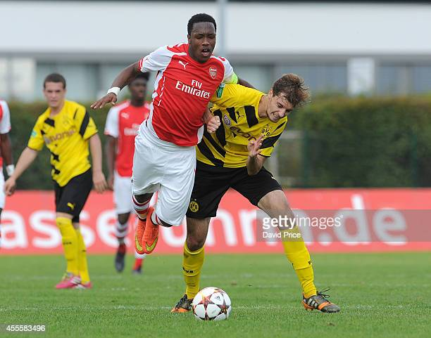 Kaylen Hinds of Arsenal is blocked by Jon Stankovic of Dortmund during the UEFA Youth League Match between Borussia Dortmund and Arsenal at...