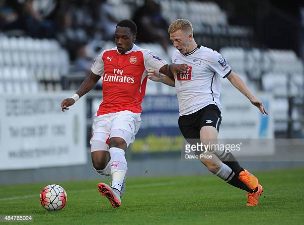 Kaylen Hinds of Arsenal is closed down by Callum Guy of Derby during the match between Arsenal U21 and Derby County U21 at Meadow Park on August 21...