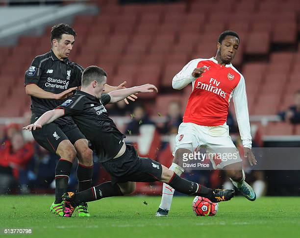 Kaylen Hinds of Arsenal is tackled by Corey Whelan of Liverpool during the match between Arsenal U18 and Liverpool U18 in the FA Youth Cup 6th round...