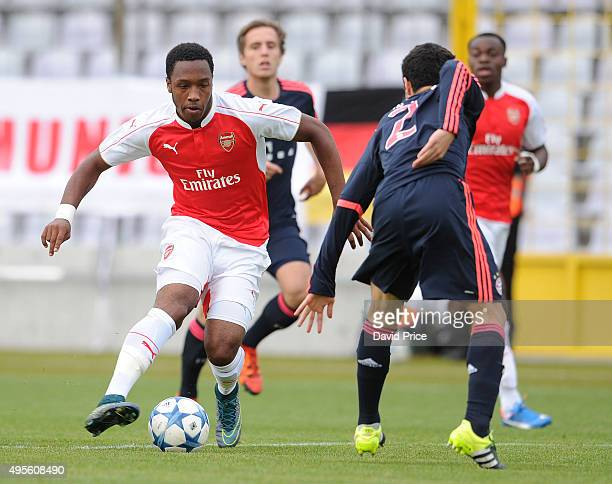 Kaylen Hinds of Arsenal runs at Resul Turkalesi of Bayern during the match between Bayern Munich U19 and Arsenal U19 at Grunwalder Stadion on...