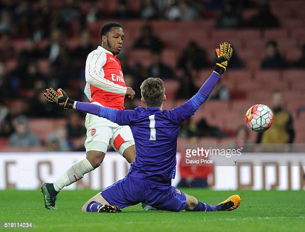 Kaylen Hinds of Arsenal shoots under pressure from Daniel Grimshaw of Manchester City during the match between Arsenal U18 and Manchester City U18 at...