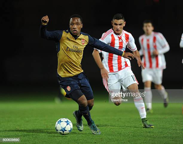 Kaylen Hinds of Arsenal takes on Laci Oazim of Olympiacos during the match between Olympiacos and Arsenal on December 9 2015 in Piraeus Greece
