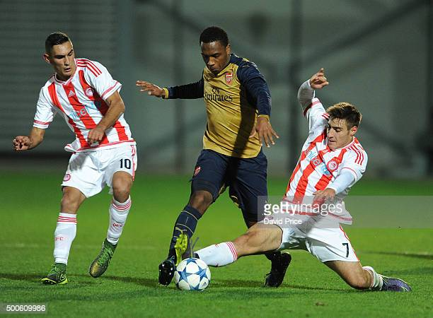 Kaylen Hinds of Arsenal takes on Laci Qazim and Manthatis Georgios of Olympiacos during the match between Olympiacos and Arsenal on December 9 2015...