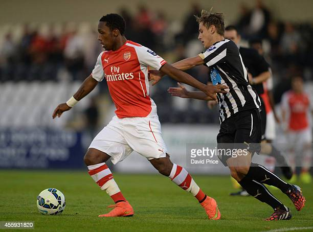 Kaylen Hinds of Arsenal takes on Liam Smith of Newcastle during the Barclays Premier U21 League match between Arsenal and Newcastle at Meadow Park on...