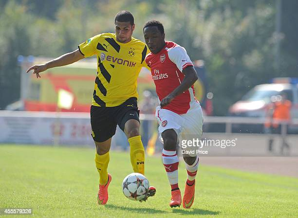Kaylen Hinds of Arsenal takes on Mohamed ElBouzzati of Dortmund during the UEFA Youth League Match between Borussia Dortmund and Arsenal at...
