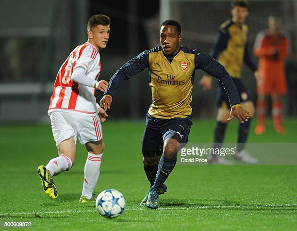 Kaylen Hinds of Arsenal takes on Retsos Panagiotis of Olympiacos during the match between Olympiacos and Arsenal on December 9 2015 in Piraeus Greece