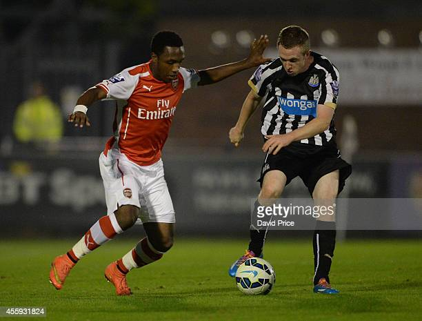 Kaylen Hinds of Arsenal takes on Shane Ferguson of Newcastle during the Barclays Premier U21 League match between Arsenal and Newcastle at Meadow...