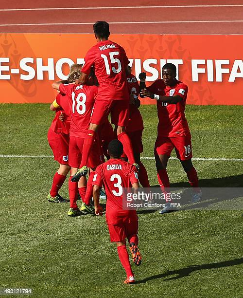 Kaylen Hinds of England celebrates with team mates after scoring a goal during the FIFA U17 World Cup Group B match between England and Guinea at...