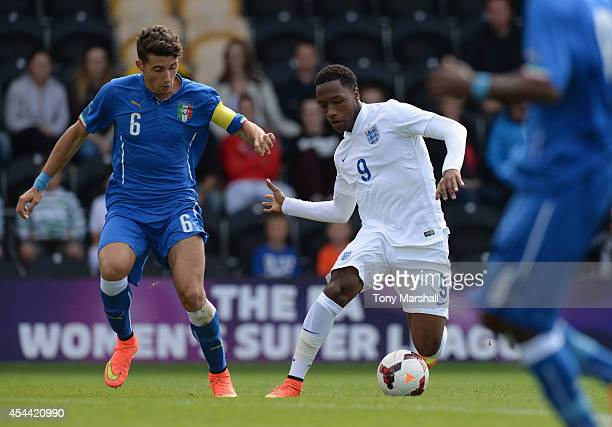 Kaylen Hinds of England is tackled by Andres Llamas Acuna of Italy during the International match betweeen Engand Under 17 and Italy Under17 at...