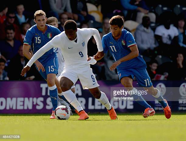 Kaylen Hinds of England is tackled by Matteo Gasperoni of Italy during the International match betweeen Engand Under 17 and Italy Under17 at Pirelli...