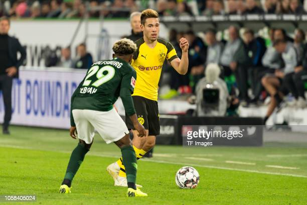 Kaylen Hinds of VfL Wolfsburg and Raphael Guerreiro of Borussia Dortmund battle for the ball during the Bundesliga match between VfL Wolfsburg and...