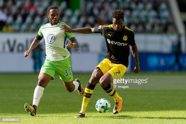 Kaylen Hinds of Wolfsburg and DanAxel Zagadou of Dortmund battle for the ball during to the Bundesliga match between VfL Wolfsburg and Borussia...