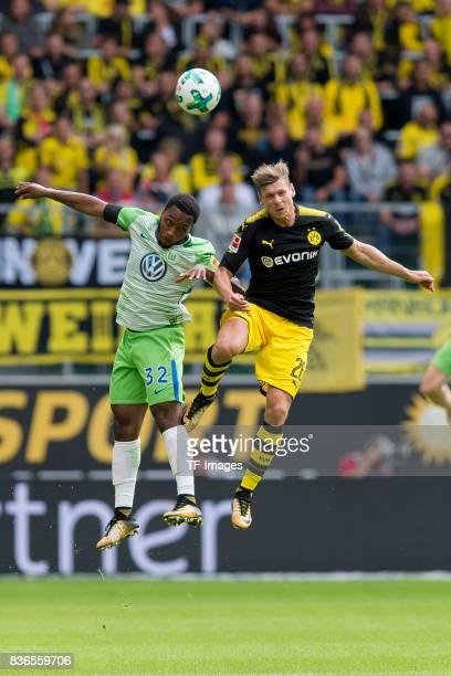 Kaylen Hinds of Wolfsburg and Lukasz Piszczek of Dortmund battle for the ball during to the Bundesliga match between VfL Wolfsburg and Borussia...