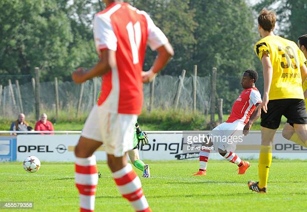 Kaylen Hinds scores Arsenal's 2nd goal past Tim Siegmeyer of Dortmund during the UEFA Youth League Match between Borussia Dortmund and Arsenal at...