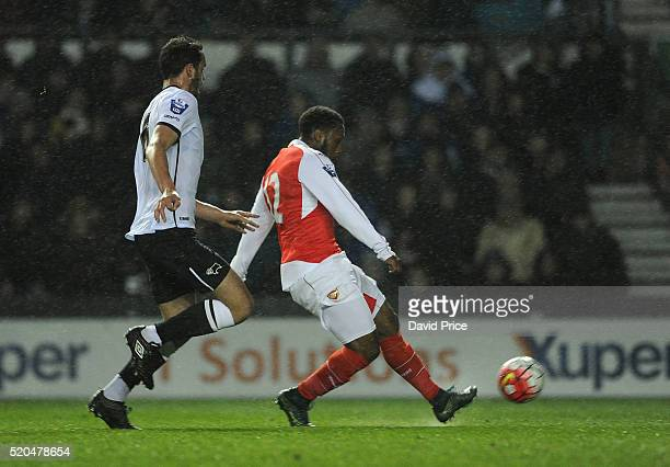 Kaylen Hinds scores Arsenal's 2nd goal under pressure from Farrend Rawson of Derby during the Barclays U21 Premier League match between Derby County...