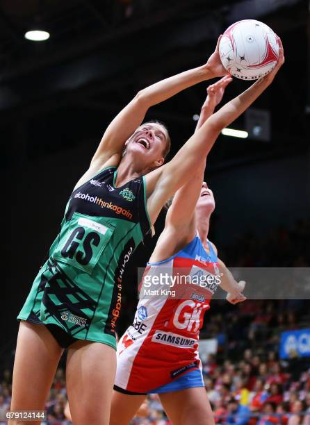Kaylia Stanton of the Fever is challenged by Sarah Klau of the Swifts during the round 11 Super Netball match between the Swifts and the Fever at...
