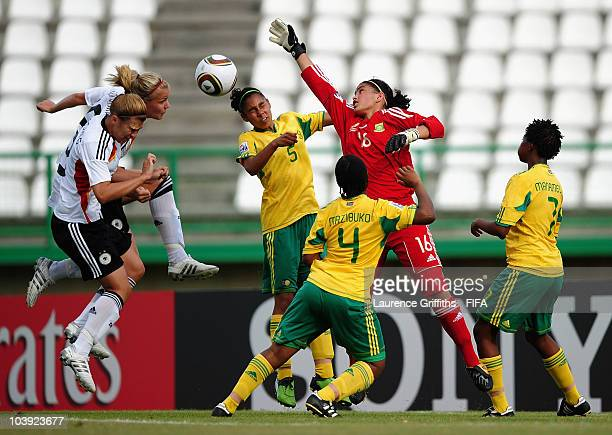 Kaylin Swart of South Africa is put under pressure from Lena Pettermann of Germany during the FIFA U17 Women's World Cup match between Germany and...