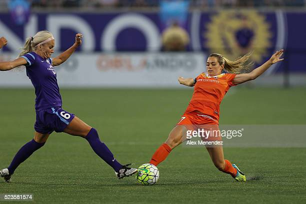 Kaylyn Kyle of Orlando Pride and Kealia Ohai of Houston Dash fight for a loose ball during a NWSL soccer match at the Orlando Citrus Bowl on April 23...