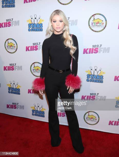 Kaylyn Slevin attends A Place Called Home's Annual Stars And Strikes Celebrity Bowling And Poker Tournament at PINZ Bowling & Entertainment Center on...