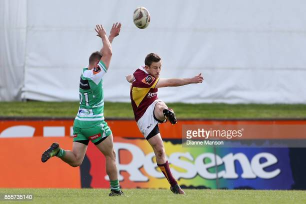 Kayne Hammington of Manawatu tries to charge down Scott Eade of Southland's kick during the round seven Mitre 10 Cup match between Southland and...