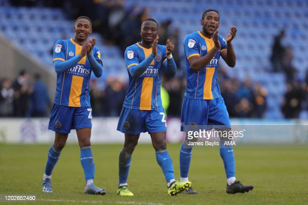 Kayne Ramsay Daniel Udoh and Omar Beckles of Shrewsbury Town celebrate winning the game at full time during the Sky Bet League One match between...