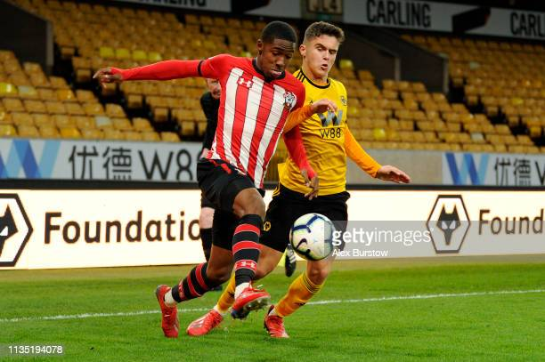 Kayne Ramsay of Southampton battles for possession with Ryan Giles of Wolverhampton Wanderers during the Premier League 2 match between Wolverhampton...
