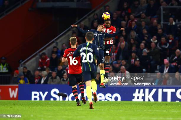 Kayne Ramsay of Southampton FC heads the ball from Man Citys Gabriel Jesus during the Premier League match between Southampton FC and Manchester City...
