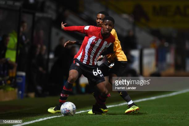 Kayne Ramsay of Southampton is challenged by Jevani Brown of Cambridge United during the Checkatrade Trophy Southern Group B match between Cambridge...