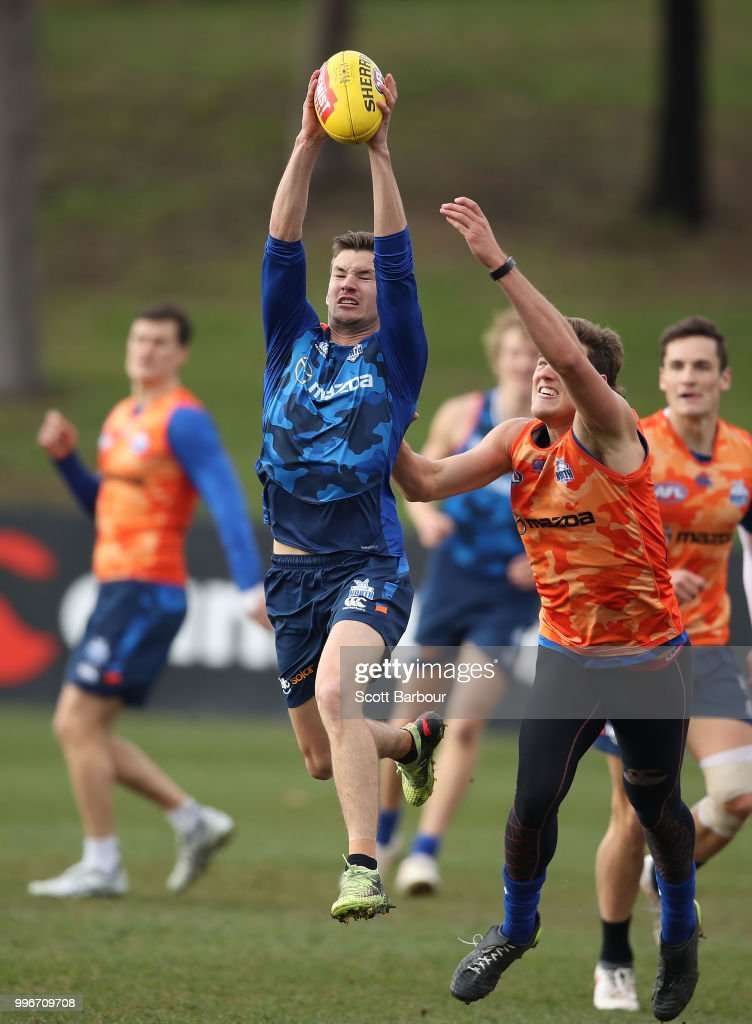 Kayne Turner of the Kangaroos marks the ball during a North Melbourne Kangaroos Training Session on July 12, 2018 in Melbourne, Australia.